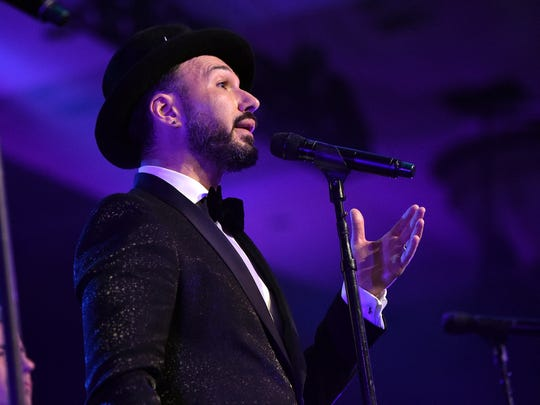 A hat became an unexpected trademark for Victor Micallef of the Tenors.