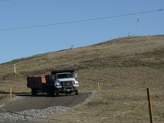 An Anderson trash truck comes back down toward the front gate, as seen from outside the Anderson Regional Landfill, from Landfill Road in Belton on January 19, 2018.