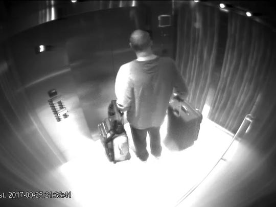 In this Sept. 25, 2017, security camera image released by MGM Resorts, Stephen Paddock stands with his luggage in an elevator at the Mandalay Bay hotel in Las Vegas. The newly released video shows the man who killed 58 people on the Las Vegas Strip.