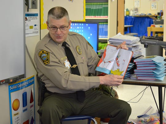 "Lt. Tom Davis of the Snow Hill Police Department reads Dr. Seuss's ""Green Eggs and Ham"" to first graders at Snow Hill Elementary School's Read Across SHES Day Wednesday, March 2."