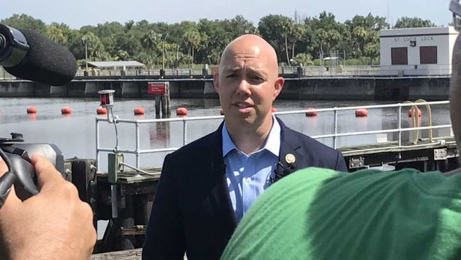 "U.S. Rep. Brian Mast, R-Palm City, talks Wednesday, Aug. 1, 2018, at the St. Lucie Lock and Dam about his proposed legislation to ""send in the cavalry"" to fight toxic algae blooms."