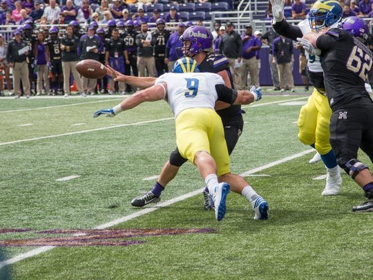 Troy Reeder tries to lower the boom on JMU quarterback Bryan Schor as he makes a pitch in last year's UD loss.