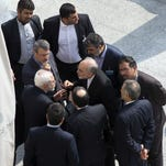 Iran's Foreign Minister Mohammad Javad Zarif (center left) and head of the Atomic Energy Organization of Iran Ali Akbar Salehi (center right) talk outside after a session of nuclear negotiations.