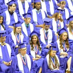 Graduates wait to receive their diplomas during the Purvis High School graduation ceremony held at the Reed Green Coliseum Saturday.