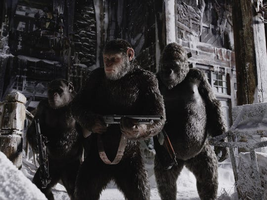 """Caesar (center, Andy Serkis via motion capture) leads a group including Rocket (Terry Notary) and Luca (Michael Adamthwaite) on a mission of revenge in """"War for the Planet of the Apes,"""" in theaters July 14."""