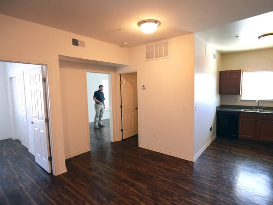 Joe Soto shows a two-bedroom unit in the Campbel Apartments