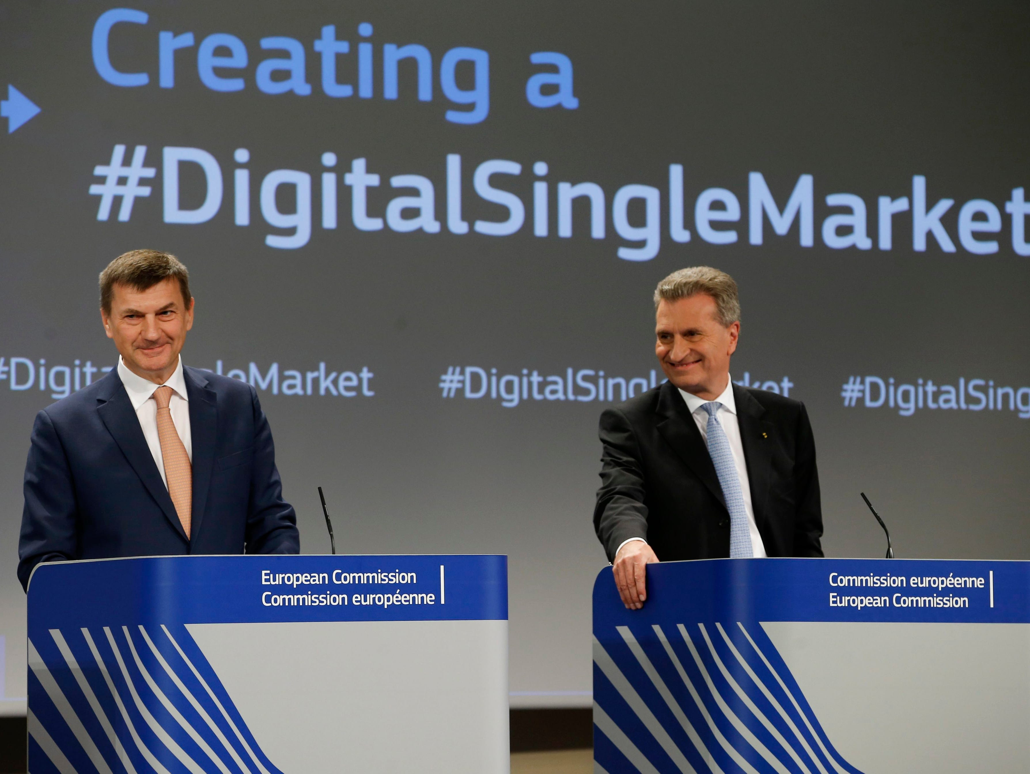 Vice President for the Digital Single Market of the European Commission Andrus Ansip, left, and EU Commissioner for the Digital Economy and Society Guenther Oettinger give a press conference on Digital Single Market Strategy at the European Commissio