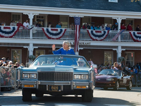 Debbie Jones, President of Return, rides in a convertible in the Return Day Parade in Georgetown.