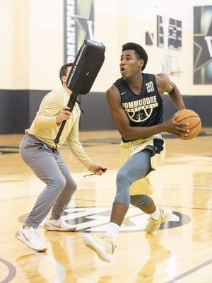 Vanderbilt assistant coach Jake Diebler works with freshman Aaron Nesmith during summer practice.