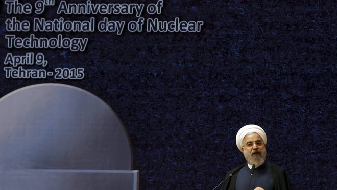 Iranian President Hassan Rouhani delivers his speech in a ceremony marking National Nuclear Technology Day, in Tehran on April 9.