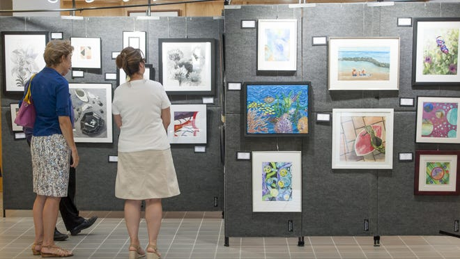 Sisters of the Brush created artworks that are on display at the South Lyon City Hall.