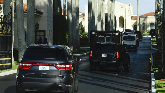 The motorcade with President Donald Trump arrives at Trump International Golf Club in West Palm Beach, Fla. on Sunday.