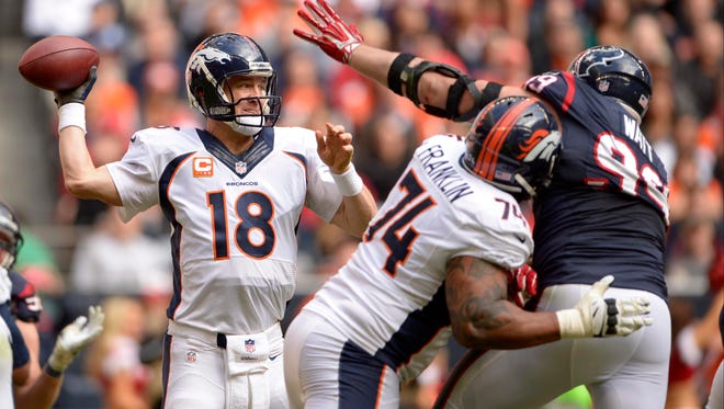 Broncos quarterback Peyton Manning threw for four touchdowns and 400 yards against the Houston Texans on fantasy championship Sunday.