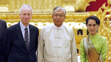 Myanmar's new Foreign Minister and State Counselor Aung San Suu Kyi , right,, Myanmar President Htin Kyaw, center, and Canadian Foreign Minister Stephane Dion, pose for a group photo during a meeting at the president's house in Naypyitaw, Myanmar, April 7, 2016.
