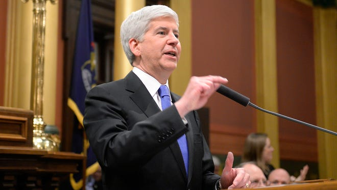 Michigan Governor Rick Snyder speaks during his State of the State Address on the floor of the House at the Capitol in Lansing tonight.                     t