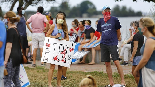 """A Hingham resident supports BLM and the Hingham Police.   Hingham residents gather for a brief """"No Place for Hate"""" rally at Hingham Harbor on Sunday August 2, 2020 Greg Derr/The Patriot Ledger"""
