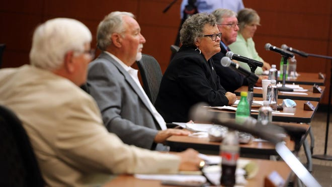Cleveland County Commissioners meet in person at the LeGrand Center in July.