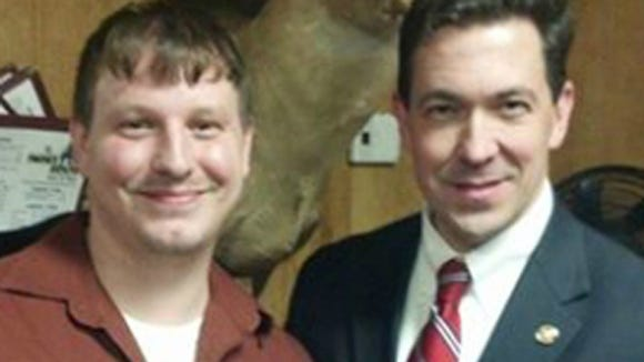 Clayton Kelly pictured with U.S. Senate candidate Chris McDaniel on Kelley's website.