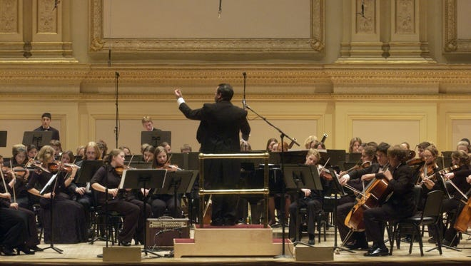 Troy Peters, former music director and conductor of the Vermont Youth Orchestra, leads his musicians as they perform Trey Anastasio's Guyute (orchestrated by Anastasio and Peters) at New York City's Carnegie Hall in 2004.