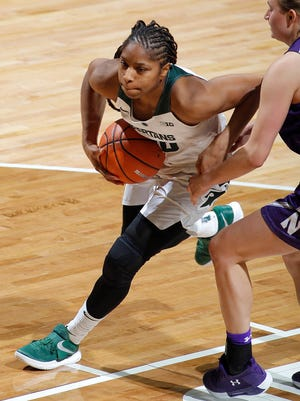 Michigan State's Branndais Agee, left, drives against Northwestern's Abbie Wolf, Wednesday, Jan. 3, 2018, in East Lansing, Mich. MSU won 81-51.
