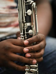 Kiyaunta Goodwin, 14, practices during music class at Olmsted Academy North.
