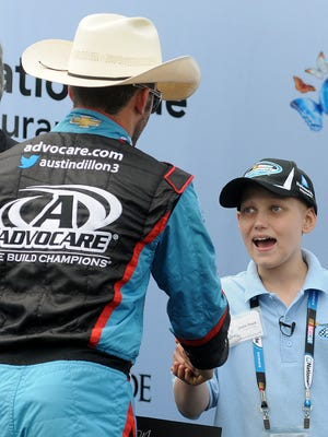 Grand Marshal Grant Reed of Bellville greets Austin Dillon during the pre-race ceremony before the start of the inaugural NASCAR Nationwide Children's Hospital 200 at the Mid-Ohio Sports Car Course.