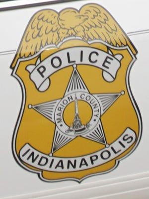 IMPD badge on patrol car