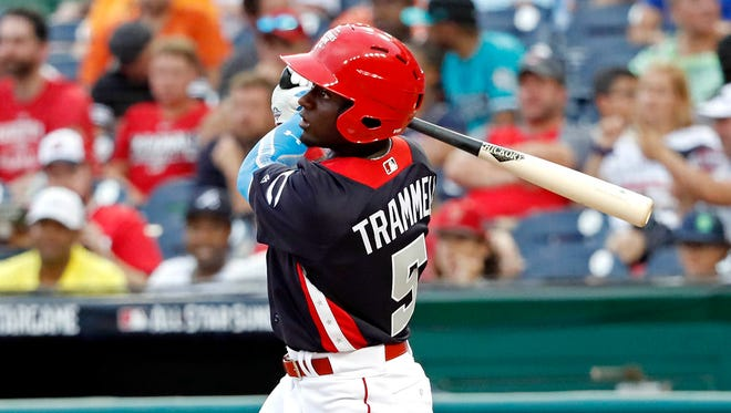 Team USA's Taylor Trammell hits a triple in the eighth inning against the World Team during the 2018 All-Star Futures Game at Nationals Park.