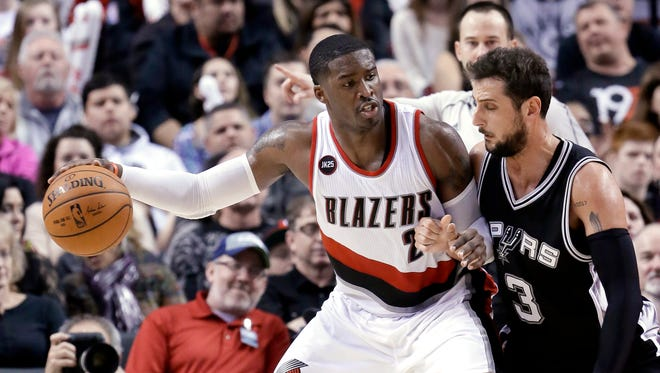 Portland Trail Blazers guard Wesley Matthews, left, works the ball in on San Antonio Spurs guard Marco Belinelli during the second half of an NBA basketball game in Portland, Ore., Wednesday, Feb. 25, 2015.  Matthews led the Trail Blazers in scoring with 31 points as Portland won 111-95.