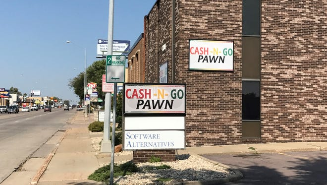 The storefront of a Cash N Go store in Sioux Falls, pictured on Sept. 14, 2017. The store and a sister site in Rapid City were shut down this week by the South Dakota Division of Banking