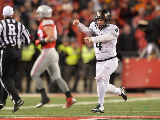 Michael Geiger celebrates after kicking a 41-yard field goal as time expired to stun undefeated Ohio State, 17-14, in 2015 in Columbus, Ohio.