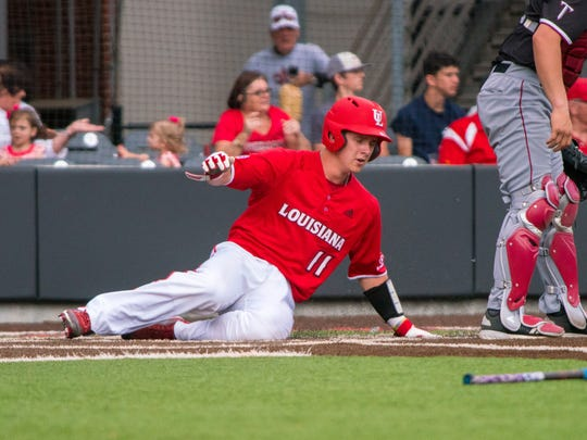 UL catcher Kole McKinnon slides home with one of the Ragin' Cajuns' runs in their 8-5 loss to Troy on Saturday.