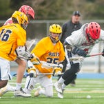 Worcester Prep midfielder Ross Dickerson (6) escapes with a ground ball against Stephen Decatur at Stephen Decatur in Berlin.