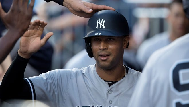 Jun 26, 2018; Philadelphia, PA, USA; New York Yankees center fielder Aaron Hicks (31) celebrates in the dugout after scoring against the Philadelphia Phillies during the third inning at Citizens Bank Park.