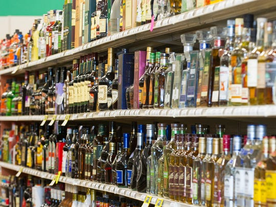 Shelves are filled with bottles of liquor at a 21st Amendment liquor store in Carmel, Ind.
