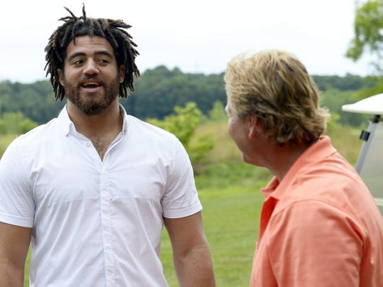 Lebanon native and Jacksonville Jaguars defensive lineman Jared Odrick talks with Tom Kintzer during the Jared Odrick Golf Classic last year at Iron Valley Golf Course. Odrick will host the third annual event on June 27.