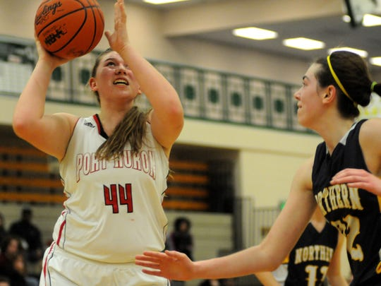 Big Reds' Kaitlyn Newman goes up for a shot Monday, Mar 2, during girls district basketball action at Macomb Dakota.