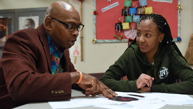 Leekia Gourzong, is active in the Teen Center at JFK High School in Paterson, NJ. The center offers various clubs and activities designed to give Paterson's young people positive options. Leekia Gourzong works with Raheem Smallwood, the site manager of the center on Friday December 08, 2017.