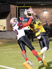 Trenton Peabody's Courtlen Wade breaks up a pass intended