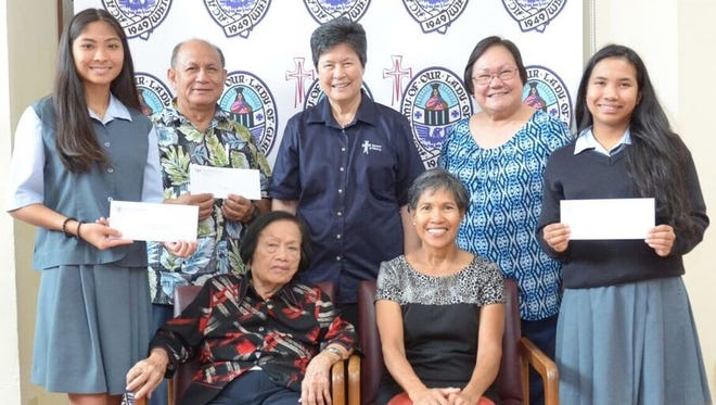 "The Academy of Our Lady of Guam is grateful for the many generous donors who have made it possible for some of its students to obtain a college preparatory Catholic secondary education. Businesswoman Elaine Cruz Jones '56 has generously donated annually to Academy's scholarship/tuition assistance fund. Her annual donation is able to help fund two students' tuition requirements. Attorney Cynthia V. Ecube '80, and Angela V. Ecube '88, donate annually to the school's scholarship and tuition assistance fund in memory of their parents, Rebecca Ecube and the late Dominador Ecube. Pilar Poblacion Malilay's daughters, who all graduated from the Academy established the Pilar Poblacion Malilay Scholarship in 2006. The Academy is also grateful to the many alumnae who donate anonymously to help with the growth of the ""sisterhood"". Ecube and Malilay scholarships were presented jointly at the school. Seated left to right Mrs. Rebecca Ecube and Mrs. Agnes Malilay  White presented the scholarships on behalf of their families. Pictured standing left to right:  Christabelle Basto (Ecube scholarship recipient), Felix Reyes (FDMS Endowment), Sr. Angela Perez, RSM (AOLG President), Mary A. T. Meeks (AOLG Principal) and Sheila Dumaraog (Malilay Scholarship recipient.)"