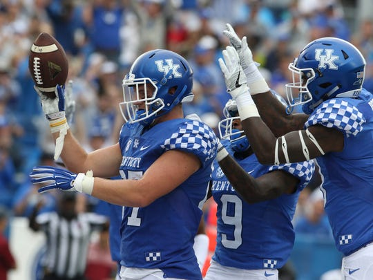 zSep 17, 2016; Lexington, KY, USA; Kentucky Wildcats tight end C.J. Conrad (87) celebrates after scoring a touchdown against the New Mexico State Aggies in the first half  at Commonwealth Stadium.