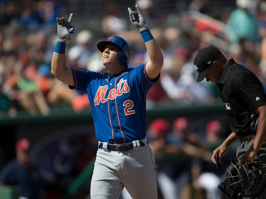 Gavin Cecchini of the New York Mets celebrates a home run Friday during a spring training game between the Red Sox and the Mets. The Mets won 3-2.