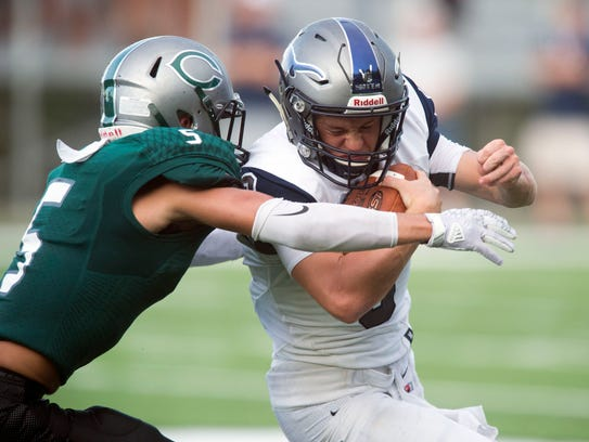 Anderson County's Stanton Martin is grabbed by Carter's