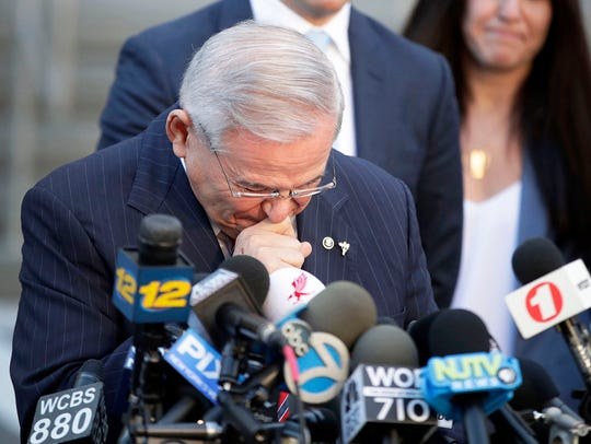 U.S. Sen. Bob Menendez fights tears as he speaks to reporters outside the federal courthouse in Newark after U.S. District Court Judge William H. Walls declared a mistrial in the senator's corruption trial on Nov. 16, 2017.