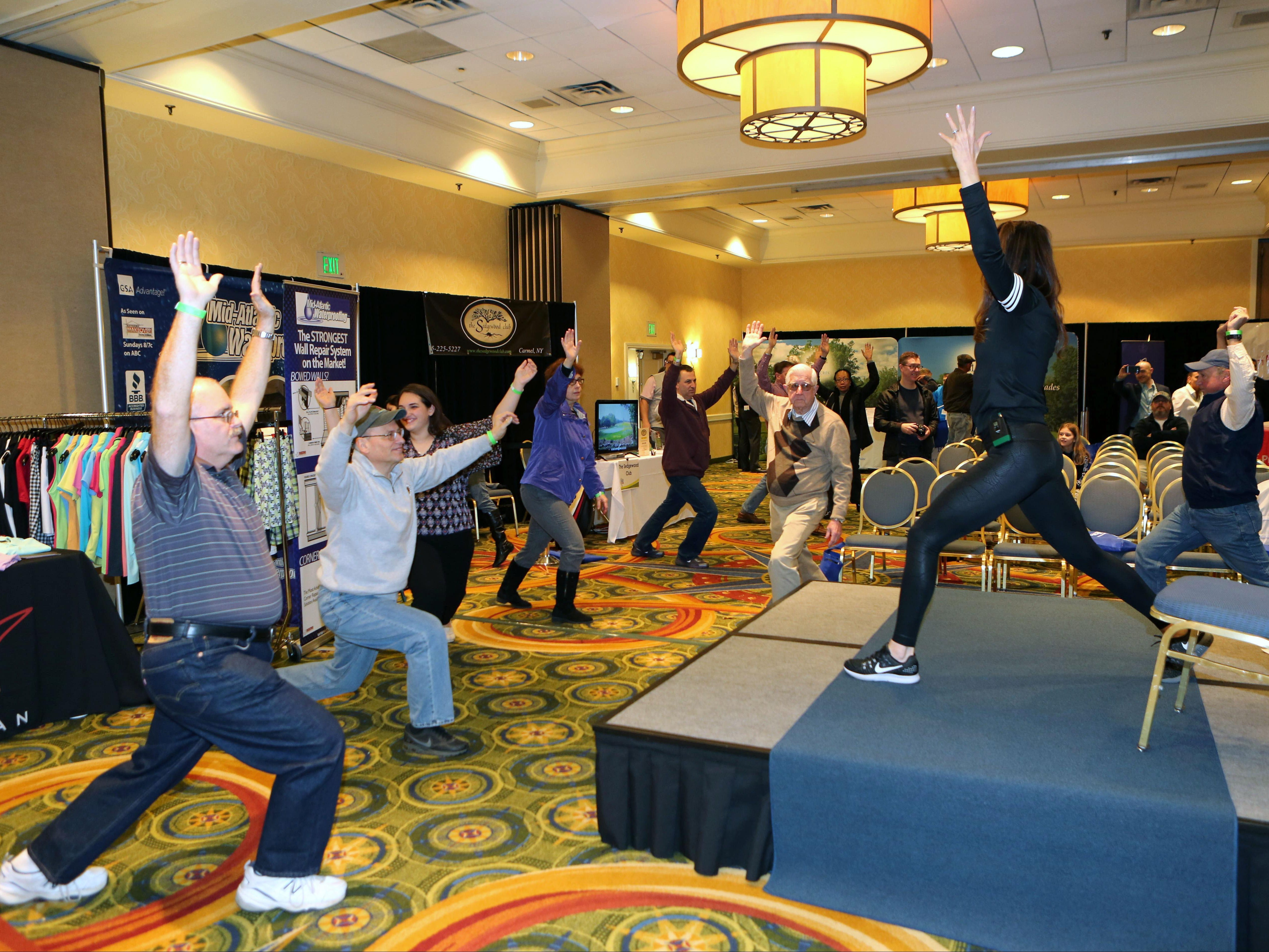 Yoga Instructor Karen Young puts attendees through some moves at the lohud.com Golf Show at the Westchester Marriott in Tarrytown Saturday. The show continues Sunday.
