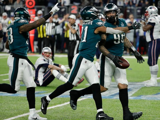 Philadelphia Eagles' Derek Barnett (96) celebrates after recovering a fumble by New England Patriots' Tom Brady, sitting, during the second half of the NFL Super Bowl 52 football game Sunday, Feb. 4, 2018, in Minneapolis. (AP Photo/Matt York)