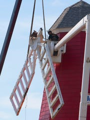 Workers from Monmouth Fabricating remove the vanes