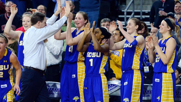 SDSU head coach Aaron Johnston celebrates with his players in the final seconds of the Jackrabbits' 72-57 win over USD in the Summit League women's basketball championship.