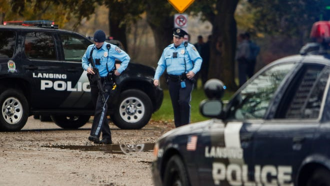 Lansing Police Department officers at the scene of a reported shooting on Irvington Avenue, just east of Hawk Island Park, on Nov. 2, 2017.