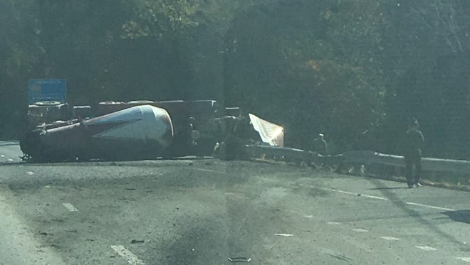 Cement truck overturned on I 24